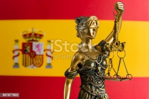 Lady justice and Spain flag.